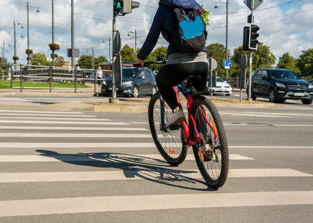 The cyclist crosses the road correctly. Reklamní fotografie