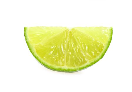 Ripe slice of green lime citrus fruit stand isolated on white background. Banco de Imagens