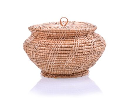 Wicker baskets and Rattan Cover on white background. Stock Photo