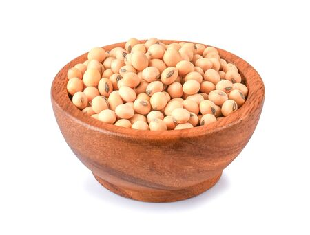 Soybeans in wooden bowl on white background.