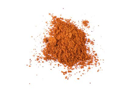 Paprika powder white background. Stock Photo