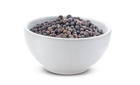 Black pepper on white background.
