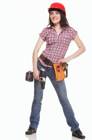 Builder woman with helmet, drill and belt of tools photo