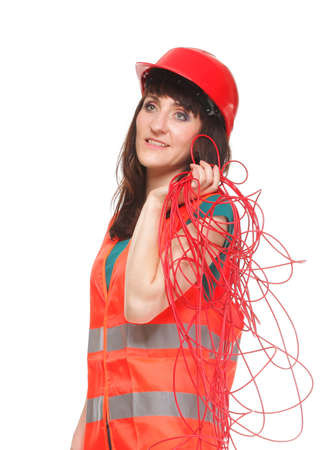 reflective vest: Builder woman in reflective vest with red cable on white background Stock Photo