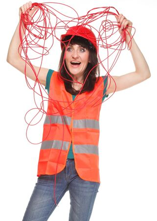 reflective vest: Builder woman in reflective vest and entangled red cable on white background Stock Photo