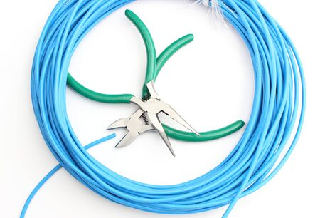 disconnecting: Metal tools with blue cable on white background