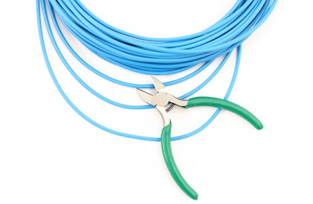 disconnecting: Metal nippers is cutting blue cable on white background