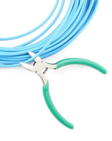 Metal nippers is cutting blue cable on white background