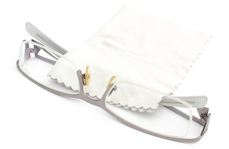 Spectacles with cleaning cloth isolated on a white background photo