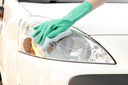 Woman s hand cleaning car using microfiber cloth photo