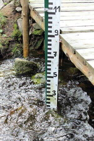 Closeup of water gauge in a mountain stream Stock Photo - 22412131