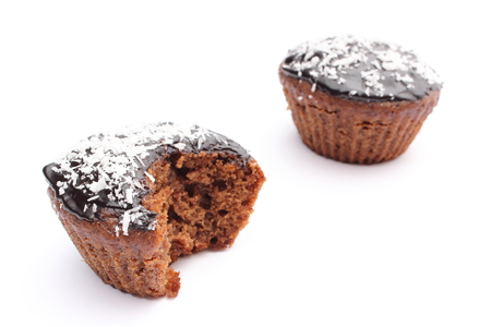 Closeup of fresh baked muffin with cacao, chocolate and desiccated coconut  Isolated on white background photo