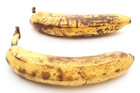 bad banana: Closeup of two overripe and old bananas isolated on white background Stock Photo
