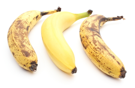 Closeup of bananas - fresh and overripe  Isolated on white background photo