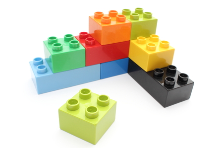 Closeup of building blocks isolated on white background