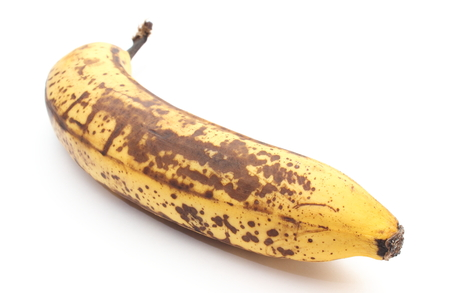 bad banana: Closeup of overripe and old banana isolated on white background