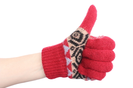 thumbs up woman: Hand of woman in colorful woolen glove showing thumbs up  Isolated on white background