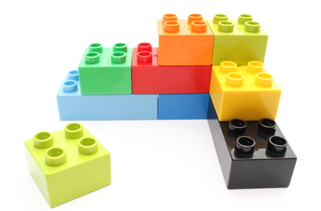 Closeup of building blocks isolated on white  photo
