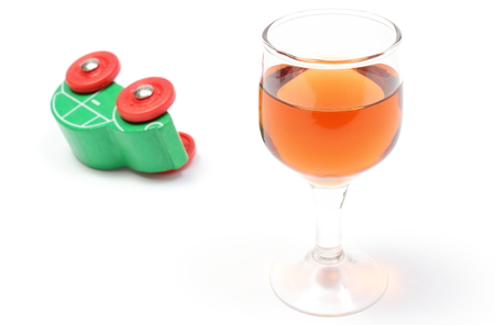 overturned: Overturned wooden toy car with glass of wine, car and alcohol, don Stock Photo