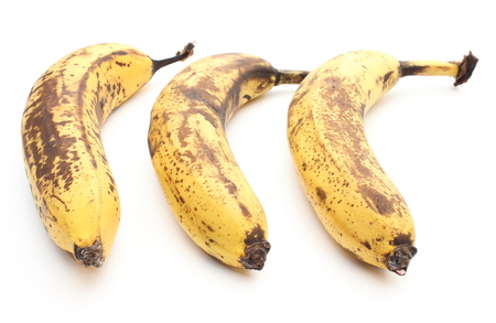 overripe: Closeup of three overripe and old bananas isolated on white