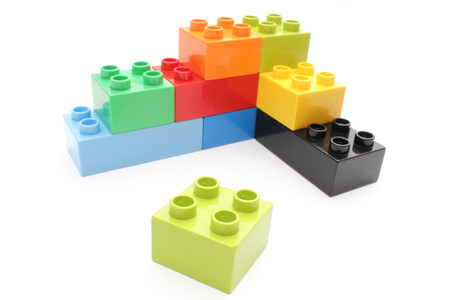 Closeup of building blocks isolated on white background photo