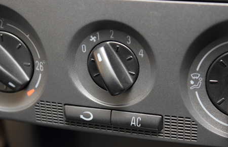 airflow: Air conditioning button in car and car ventilation knob for regulating speed of incoming airflow