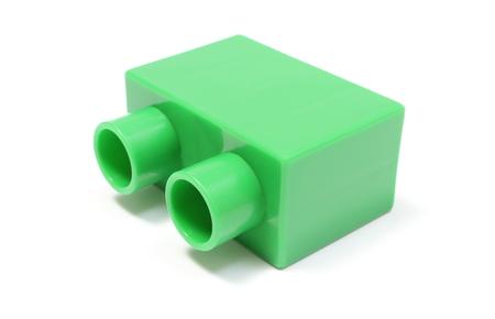 bioedilizia: Primo piano del building block verde, blocchi di costruzione per bambini isolato su sfondo bianco Archivio Fotografico