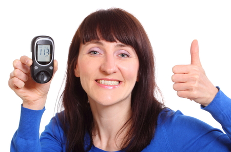 thumbs up woman: Smiling woman holding glucose meter and showing thumbs up, measuring sugar level  approval of situation  Isolated on white background Stock Photo