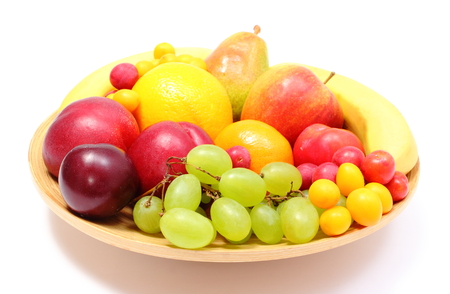 Fresh ripe fruits lying on wooden plate, desk of fruits, concept for healthy eating  Isolated on white background photo
