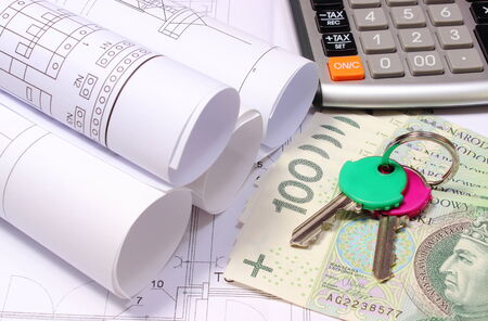 Rolled Electrical Diagrams On Construction Drawing Of House And Heap Of  Banknotes With Home Keys,