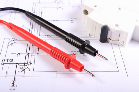 Cables of multimeter and electric fuse lying on construction drawings of house, electrical drawings and tools for engineer jobs Stok Fotoğraf