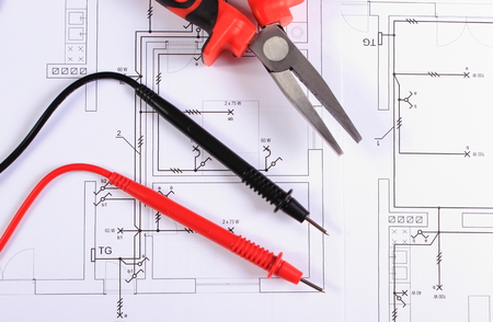 Cables of multimeter metal pliers electric wire and fuse on 34300420 cables of multimeter and metal pliers lying on construction drawings of house electrical drawings and work tools for engineer jobs asfbconference2016 Gallery