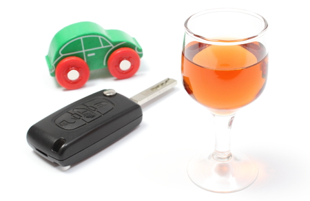 dont drink and drive: Closeup of glass of wine with car key and old wooden toy car, key car and alcohol, dont drink and drive concept. Isolated on white background Stock Photo