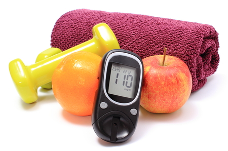 healthy nutrition: Glucose meter, fresh fruits, dumbbells and purple towel for using in fitness, concept for diabetes lifestyle and healthy nutrition