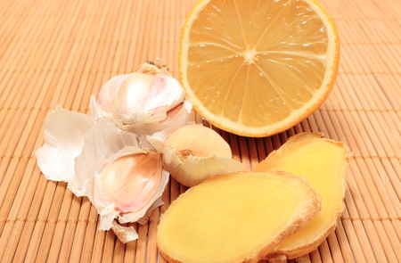 ginger health: Garlic, lemon and ginger on wooden background, fresh and healthy food products, concept for healthy nutrition and health