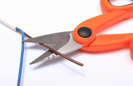 cable cutter: Cable cutter and electric wire on white background, accessories for engineer jobs and repair of electrical cable