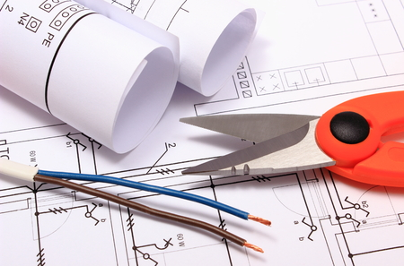 cable cutter: Cable cutter, electric wire and rolls of electrical diagrams lying on construction drawing of house, accessories for engineer jobs