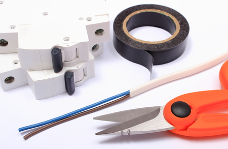 cable cutter: Cable cutter, electric wire and fuse, insulating tape lying on white background, accessories for engineer jobs, repair of cable Stock Photo