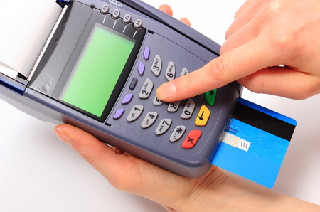 personal identification number: Hand of woman using payment terminal, enter personal identification number, credit card reader, finance concept