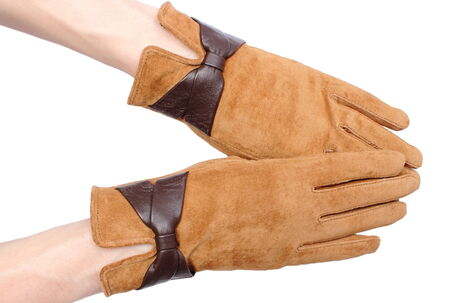 ladylike: Closeup of suede gloves for woman, beautiful brown leather gloves. Isolated on white background Stock Photo