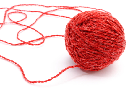 wool ball: Closeup of entangled red wool and wool ball on white background