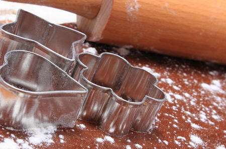cookie cutters: Cookie cutters and rolling pin lying on dough for cookies
