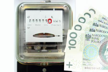 electromechanical: Money and electric energy meter old electromechanical type Stock Photo