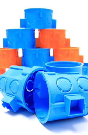Heap Of Blue And Orange Plastic Electrical Boxes, Components.. Stock ...