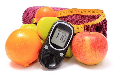 Glucose meter, fresh fruits, tape measure, dumbbells and purple towel for using in fitness, concept for diabetes lifestyle and healthy nutrition photo