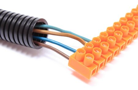 plastic conduit: Corrugated plastic pipe and electrical cable with connection cube Stock Photo