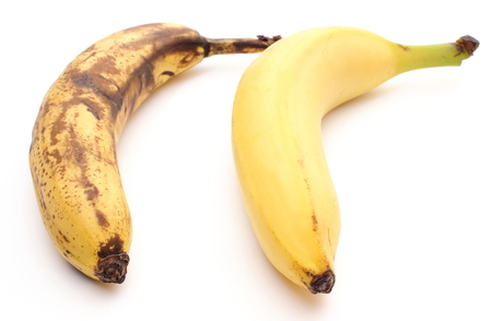 overripe: Closeup of bananas - fresh and overripe. Isolated on white background