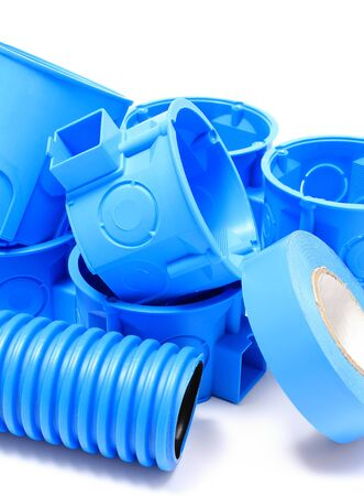 junction pipe: Heap of blue electrical boxes and components for use in electrical installations, accessories for engineering jobs