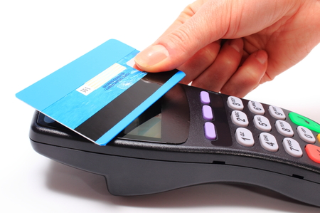 contactless: Hand of woman paying with contactless credit card with NFC technology, credit card reader, payment terminal, finance concept