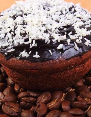 desiccated: Homemade delicious fresh baked chocolate muffins with desiccated coconut and coffee grains, concept for dessert